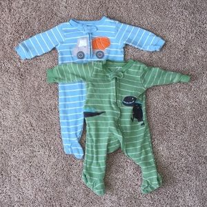 2 carter's footed pajamas. Size 3 months.